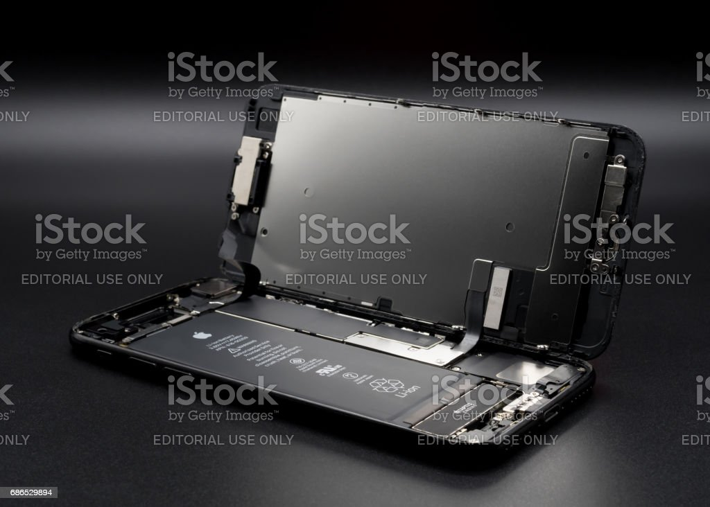Apple iPhone 7 disassembled showing components inside stock photo