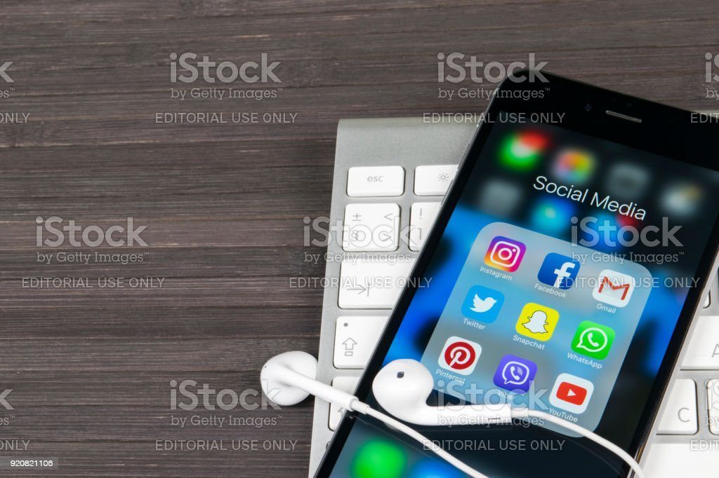 Apple Iphone 7 On Office Desk With Icons Of Social Media Facebook
