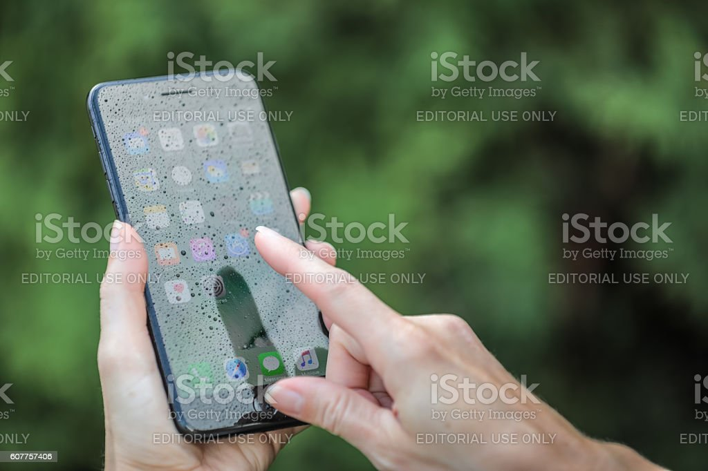 Apple iPhone 7 Plus Home Screen with Raindrop on Screen stock photo
