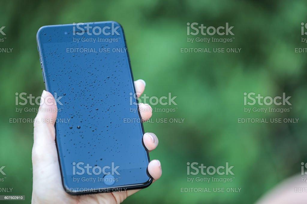 Apple iPhone 7 Plus Lock Screen with Raindrop on Screen stock photo
