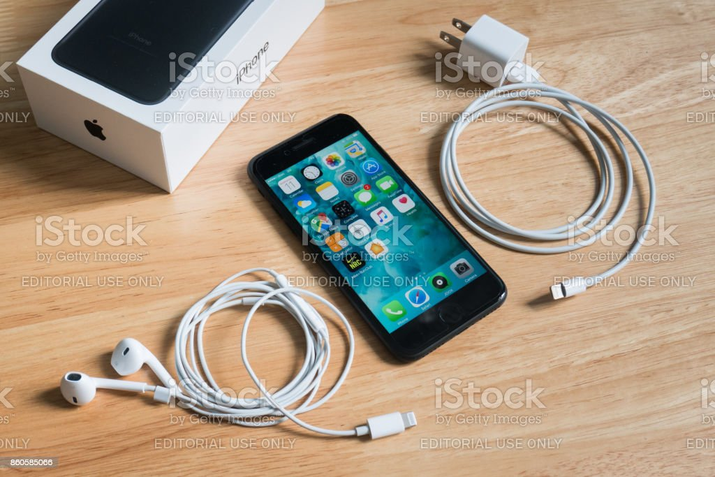 Apple iPhone 7 with Earpods, power adapter and the box package. stock photo