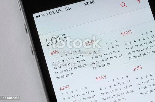 Bristol, United Kingdom - June 15, 2013: Apple iPhone iOS7, close up of the new design for the calendar app. Apple has eschewed the skeuomorphism of previous versions of the OS in favour of a cleaner, simplified design, the previous calendar had faced criticism for using leather textures and ripped paper affects. The new operating system was announced at Apple's Worldwide Developer Conference in San Francisco on June 10, 2013. Phone shown is an iPhone 4s running the developer beta release.
