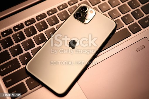 Minsk, Belarus - 11 December 2019 : Apple iphone pro on laptop keyboard. Illustrative editorial