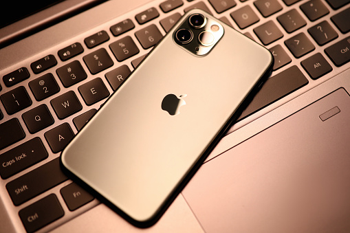 Apple iphone pro on laptop keyboard