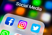 istock Apple iPhone X on office desk with icons of social media facebook, instagram, twitter, snapchat application on screen. Social network. Starting social media app. 929731224