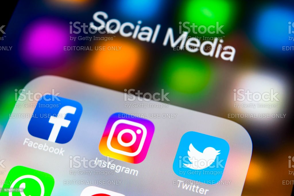 Apple iPhone X on office desk with icons of social media facebook, instagram, twitter, snapchat application on screen. Social network. Starting social media app. stock photo