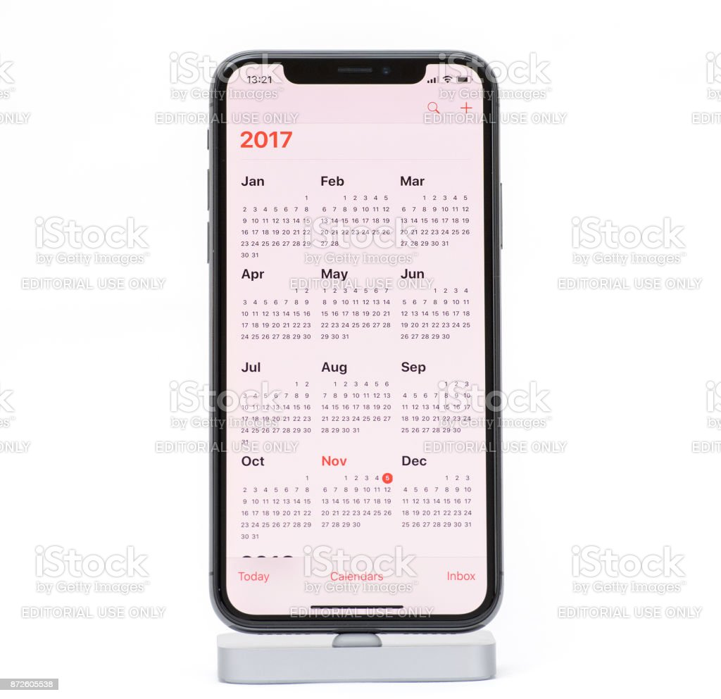 Apple iPhone X Smartphone against white background with callendar for 2017 stock photo