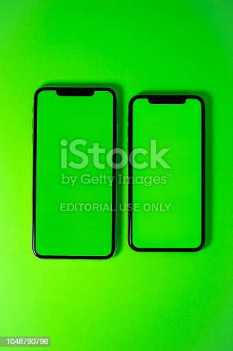 istock Apple iPhone Xs Max against vibrant green background 1048790796