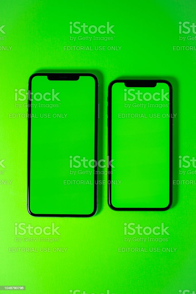 Apple iPhone Xs Max against vibrant green background stock photo