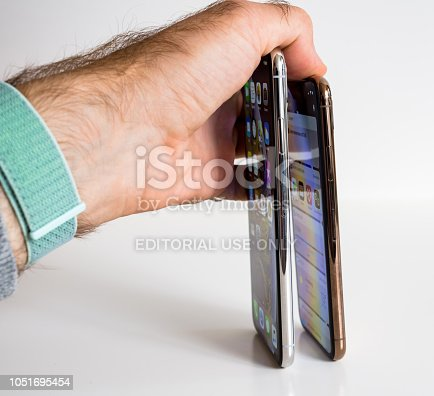 istock Apple iPhone Xs Max Gold Silver Smartphone compare thickness, 1051695454
