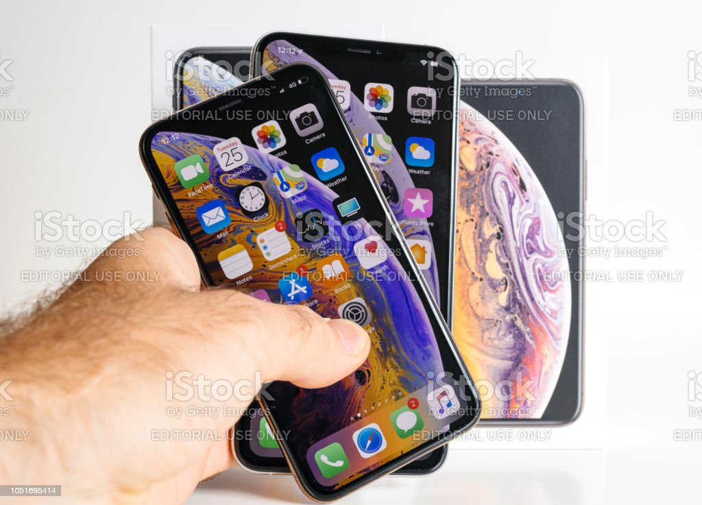 Apple Iphone Xs Max Gold Silver Smartphone In Mans Hand
