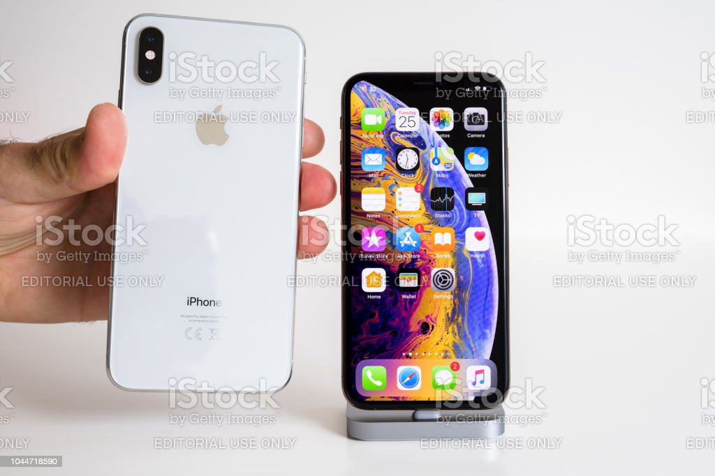Apple iPhone Xs Max Gold Silver Smartphone logo and glass back stock photo