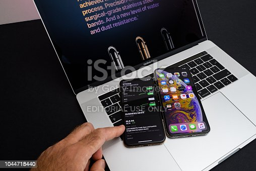 istock Apple iPhone Xs Max Gold Silver Smartphone on laptop 1044718440