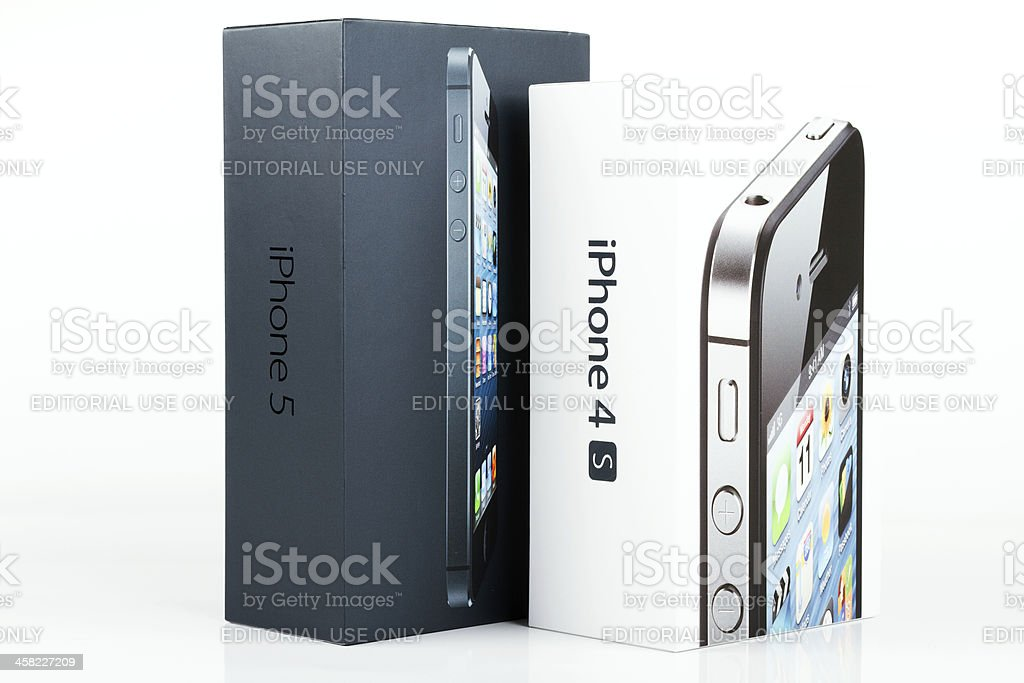 Apple iPhones 4S and 5 original boxes royalty-free stock photo