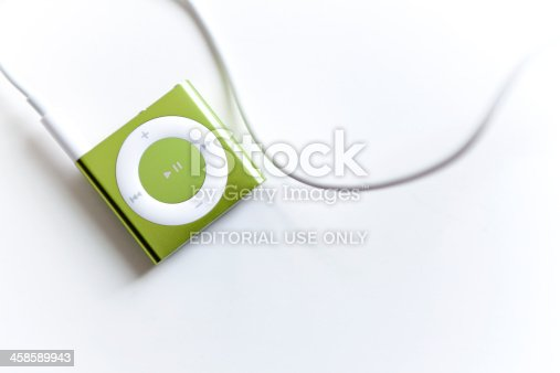Portland, Oregon, USA - May 24, 2011: Apple iPod Shuffle, 4th Generation, is the very small portable mp3 player that will play your music, podcasts or audio books with the new VoiceOver function to help with navigation between songs and playlists.