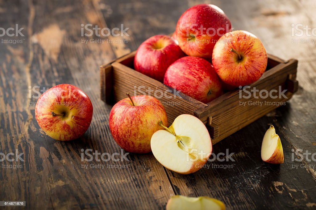 apple isolated on wood background stock photo