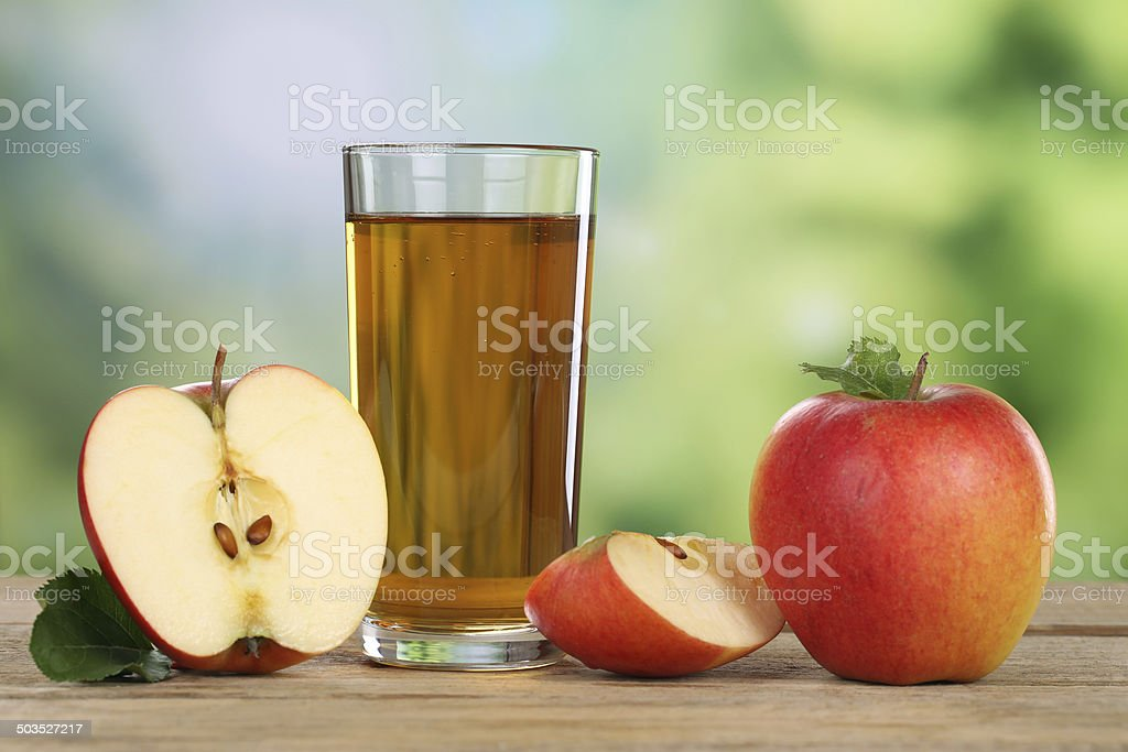 Apple juice and red apples in summer stock photo
