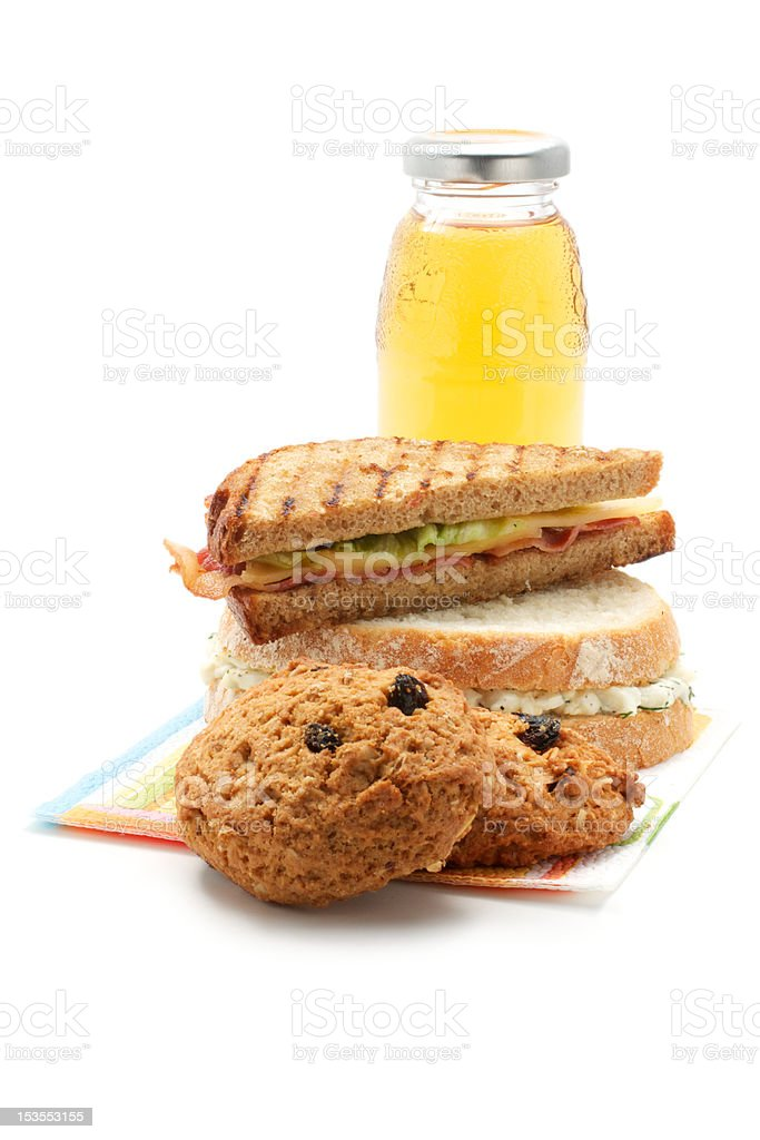 Apple juice, cookies, sandwiches royalty-free stock photo