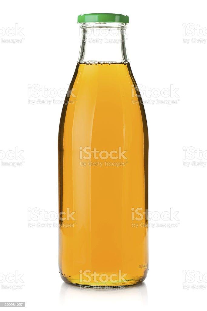 Apple juice in a glass bottle stock photo