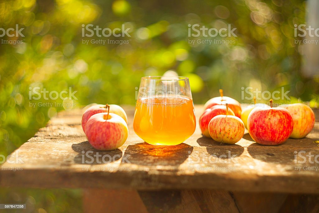 Apple juice in glass on  table stock photo