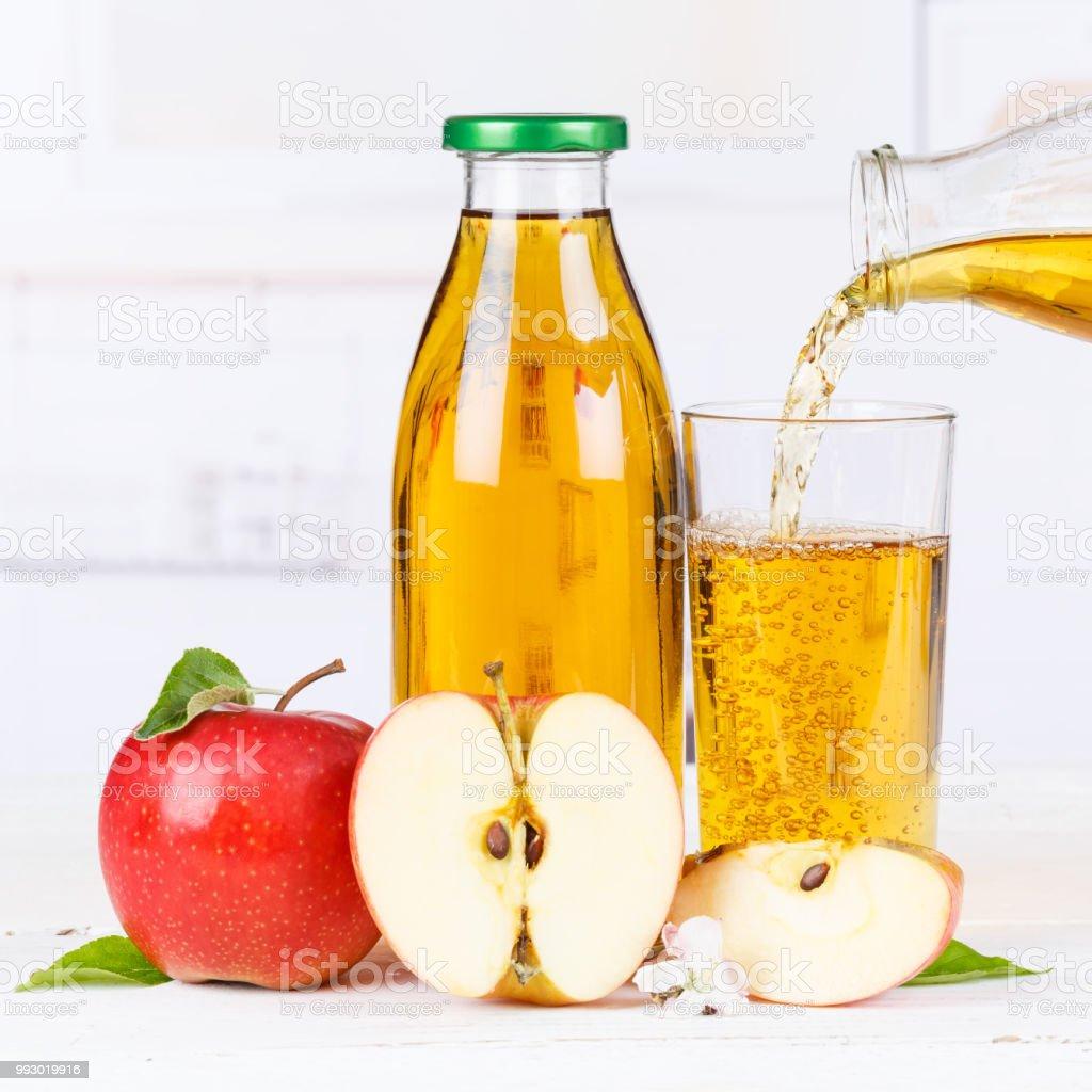 Apple juice pouring pour apples fruit fruits bottle square stock photo