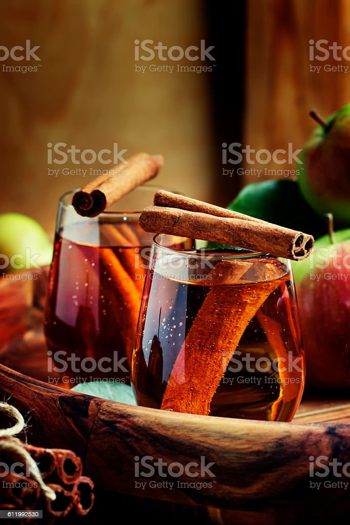 Apple juice with cinnamon in a glass stock photo