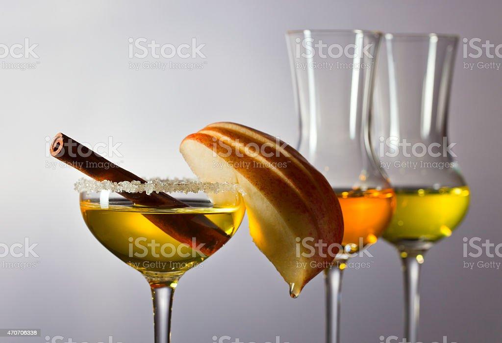 apple liquor with cinnamon stock photo