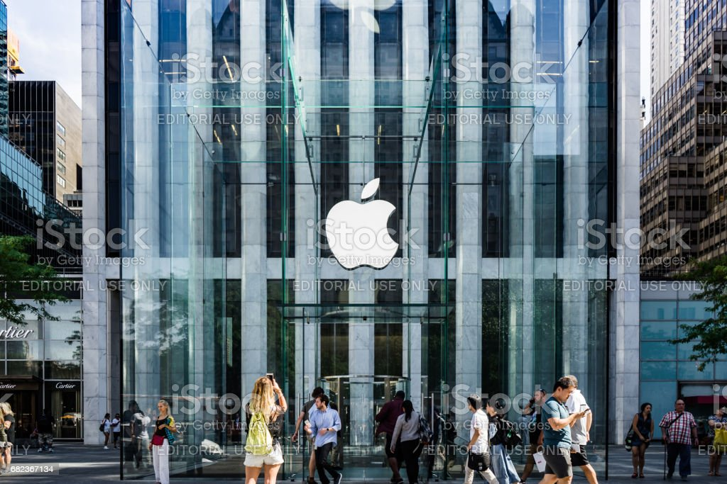 Apple Logo hung in the glass cube entrance to the famous Fifth Avenue Apple Store in New York. stock photo