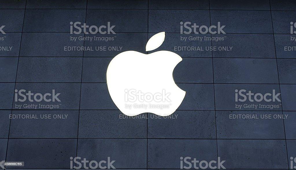 apple logo on dark blue brick royalty-free stock photo