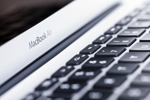 Macbook Air Apple Computer Portatile - Fotografie stock e altre immagini di Aereo ultraleggero