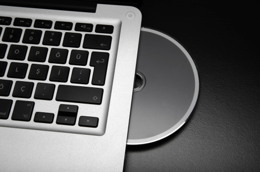 Apple MacBook Pro and Blank CD