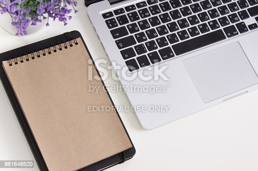 istock Apple Macbook Pro Retina on a desk with stationery. Mockup for decal, sticker design. Trendy office, freelance workplace 881648520