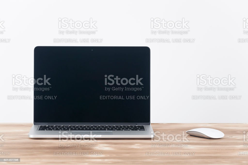 Apple MacBook Pro.with Apple magic mouse 2 on table. stock photo