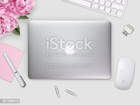 Apple Macbook Pro Retina cover on a desk, table with mouse and stationery. Mockup for cover, decal, sticker design. Trendy office, freelance workplace, top view. White background.