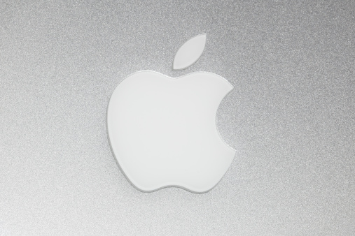 Merano, Italy - August 24, 2011: the Apple Macintosh logo on the back of a Macbook Pro