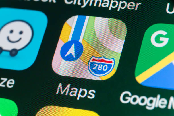 Apple Maps, Google Maps, Waze and other Apps on iPhone screen - foto stock