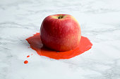 An apple melting on a marble background. minimal color still life photography