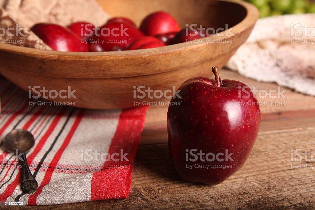 Apple next to bowl stock photo