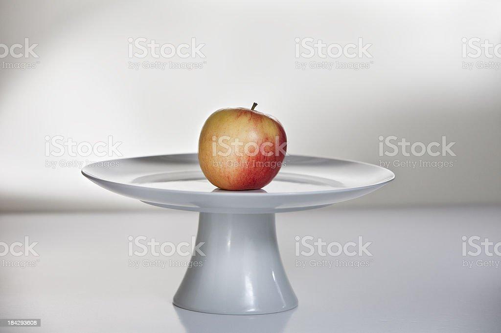 Apple on a Cake pedestal royalty-free stock photo