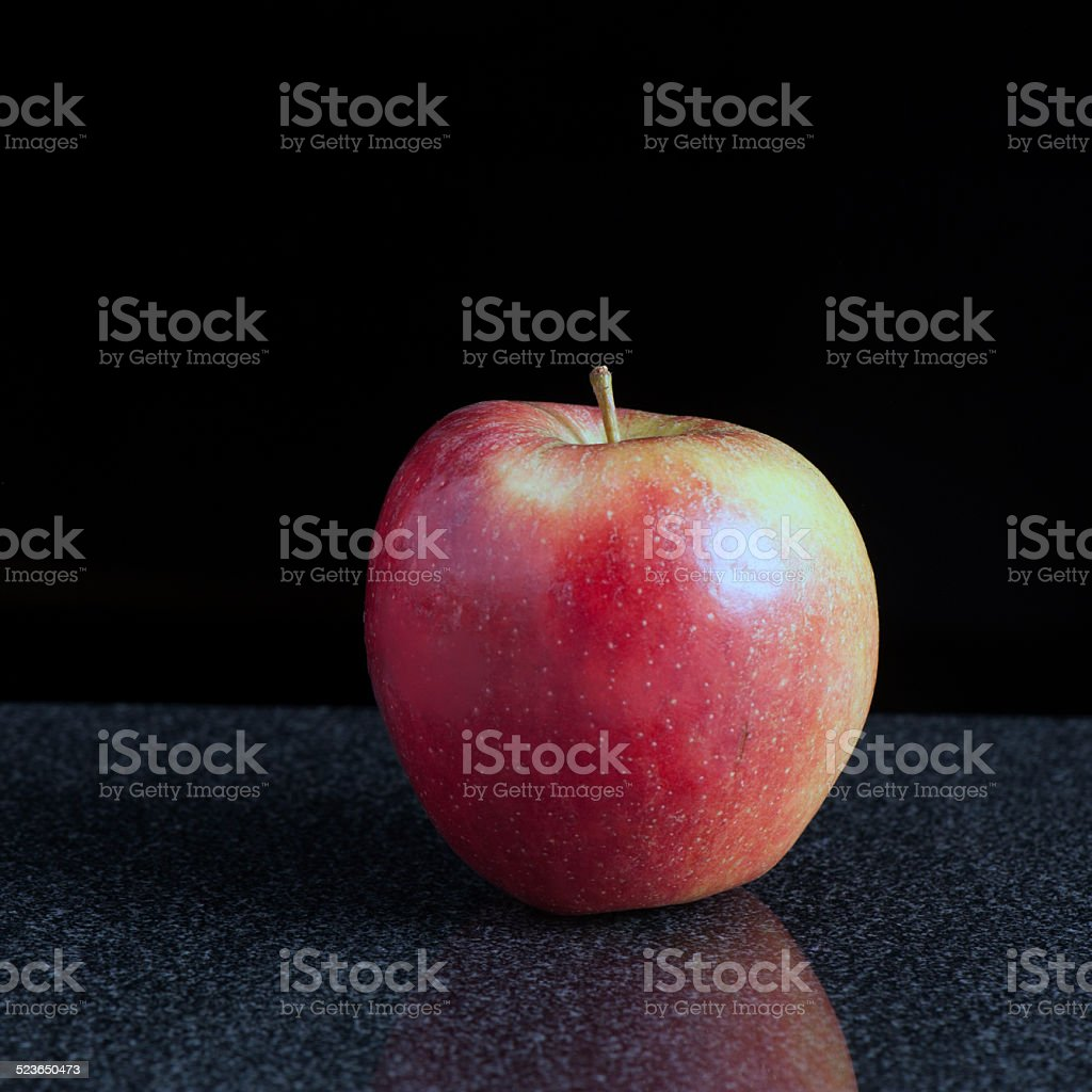 Apple on a Granite Surface stock photo