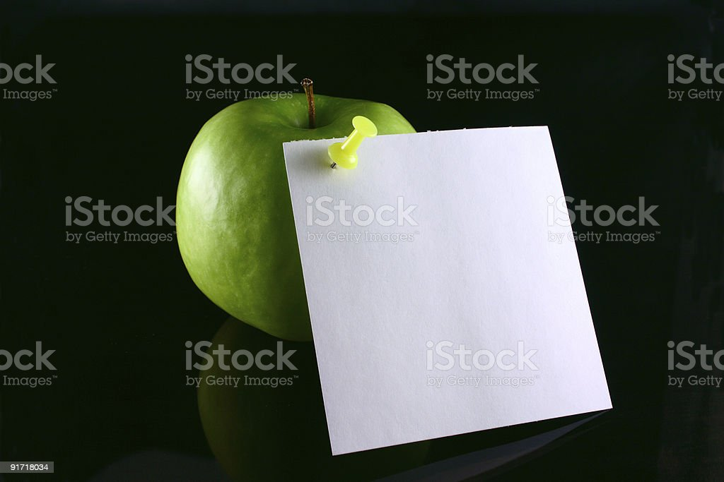 Apple on a note royalty-free stock photo
