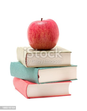 453684295istockphoto Apple on a Stack of Book isolated on white background 166518164