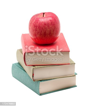 453684295istockphoto Apple on a Stack of Book isolated on white background 172476902