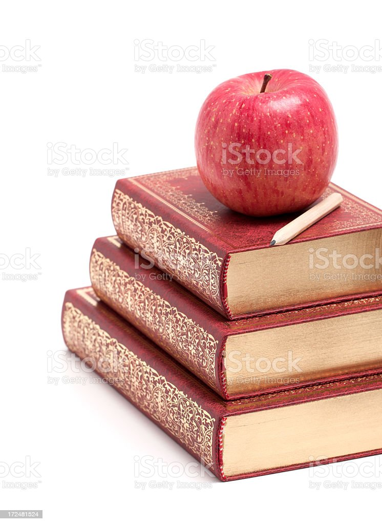 Apple on a Stack of Book isolated on white background royalty-free stock photo
