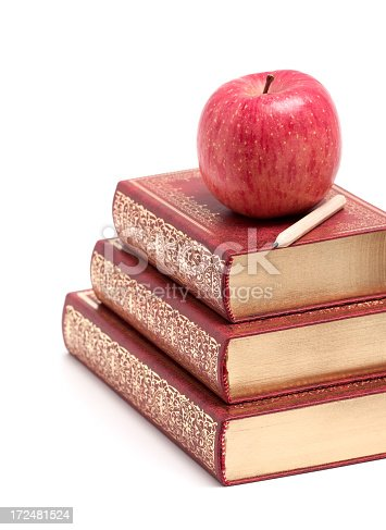 453684295istockphoto Apple on a Stack of Book isolated on white background 172481524