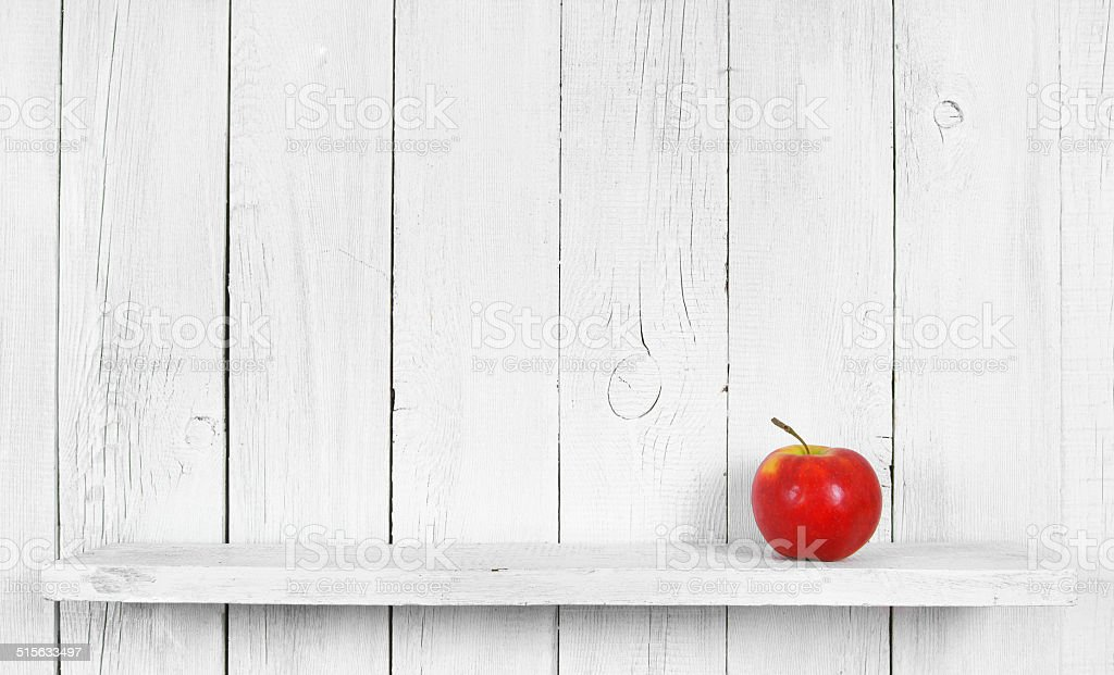 Apple on a wooden shelf. stock photo