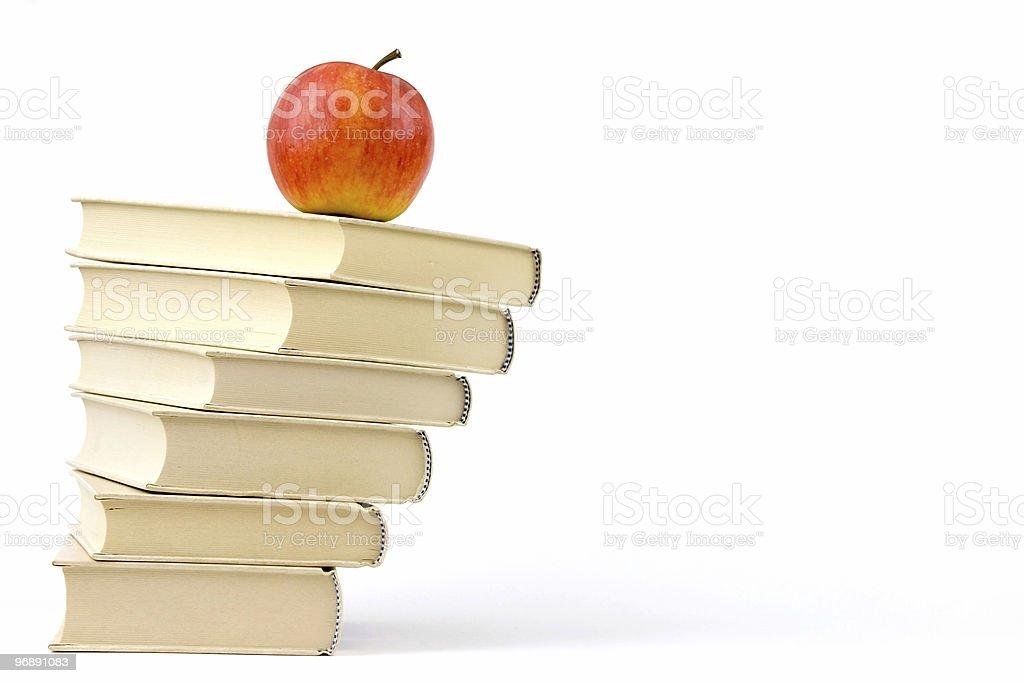 Apple on books royalty-free stock photo