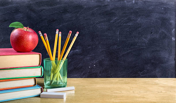 apple on books with pencils and empty blackboard - back to school stock photos and pictures