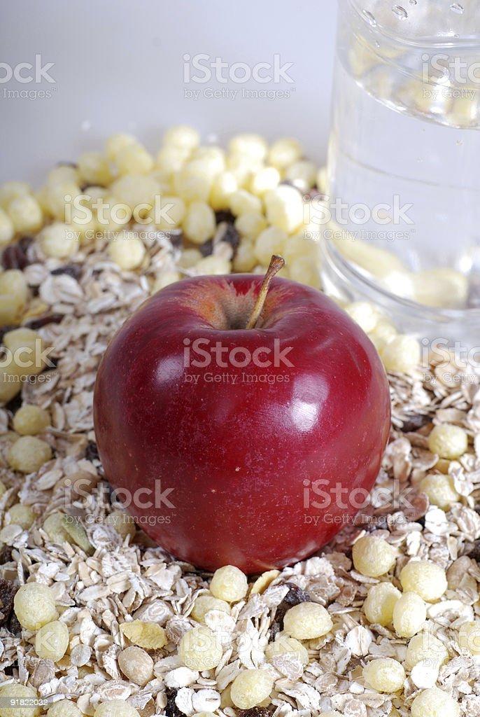 apple on muesli background royalty-free stock photo