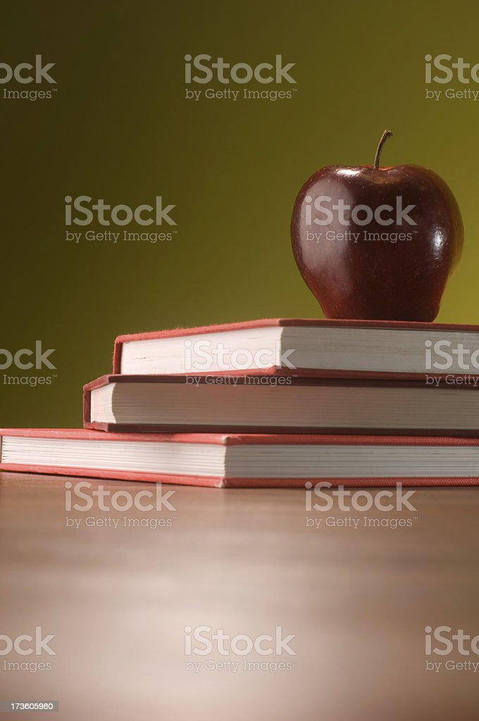 apple on red books royalty-free stock photo